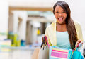 Excited shopping woman looking at her purchases Royalty Free Stock Photography