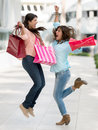 Excited shopping women jumping and holding bags Royalty Free Stock Photography