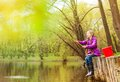 Excited small girl fishing near beautiful pond Royalty Free Stock Photo