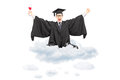 Excited student holding diploma seated on cloud and gesturing ha Royalty Free Stock Images