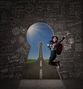 Excited student jumping on keyhole Royalty Free Stock Photo