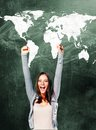 Excited student woman is standing with chalk board behind her Royalty Free Stock Photo