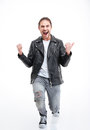 Excited successful young man shouting and celebrating victory over white background Stock Photo