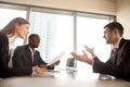 Excited surprised multi-ethnic recruiters listening to businessm
