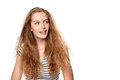 Excited teen girl looking to the side in amazement surprised happy young woman sideways excitement Stock Image