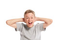 Excited teenage boy holding his head isolated on white background Stock Photography