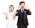 Excited wife and calm husband closeup portrait of couple men closing his eyes quiet trying to avoid situation women being active Royalty Free Stock Images
