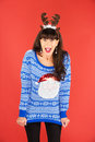 Excited woman in antlers tiara and sweater Royalty Free Stock Photo