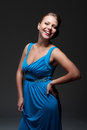 Excited woman in blue dress Royalty Free Stock Photo