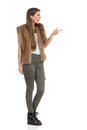 Excited Woman In Brown Fur Waistcoat Pointing Profile Royalty Free Stock Photo