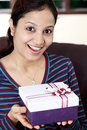 Excited woman with gift box Royalty Free Stock Images