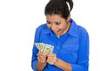 Excited woman holding cash closeup portrait of super happy successful business funny looking face money dollar bills in hand Stock Image