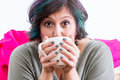 Excited woman holding coffee mug Royalty Free Stock Photo