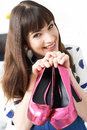 Excited Woman Holding Pair Of New Shoes Royalty Free Stock Photo
