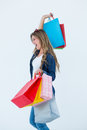 Excited woman holding some shopping bags on white background Stock Images