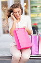 Excited woman looking into shopping bag young with bags Royalty Free Stock Photography