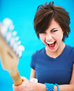 Excited woman playing guitar with copyspace Royalty Free Stock Photos