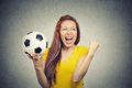 Excited woman screaming celebrating football team success portrait holding Royalty Free Stock Photography