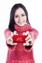 Excited woman showing gift card Stock Images
