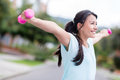 Excited woman training outdoors with arms up looking very happy Stock Photos
