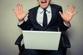 Excited young businessman with laptop Royalty Free Stock Photo