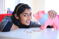 Excited young girl with piggybank Stock Images