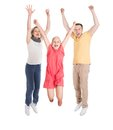 Excited young happy family jumping Stockfotos