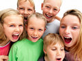 Excited young kids laughing and smiling Royalty Free Stock Images