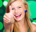 Excited young lady showing thumb's up sign Stock Photos