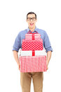 Excited young man holding presents isolated on white background Stock Photo