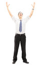 Excited young man with raised hands full length portrait of an isolated on white background Royalty Free Stock Images