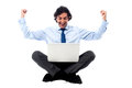 Excited young professional with laptop successful businessman Royalty Free Stock Images