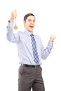 Excited young professional man gesturing happiness with medal in his hand isolated on white background Royalty Free Stock Images
