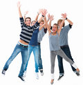 Excited young students jumping for joy Stock Photography