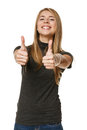Excited young success woman giving thumbs up over white background Royalty Free Stock Photography