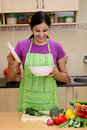 Excited young woman her in kitchen indian Stock Images