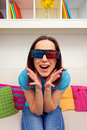 Excited young woman stereo glasses sitting sofa watching d film Stock Image