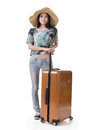 Exciting asian woman drag a luggage full length portrait isolated on white background Stock Photography