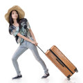 Exciting asian woman drag a luggage full length portrait isolated on white background Stock Image