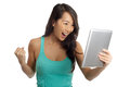 Exciting Asian Woman holding digital tablet Stock Photography