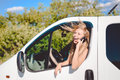 Exciting Blond Female At The Wheel Speaking By Royalty Free Stock Photo