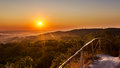 Exciting sunrise over fogged city and park, aerial view, Lviv