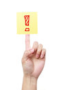 Exclamation mark a yellow sticky note with a on a finger isolated on white background Stock Images