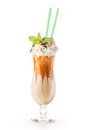 Exclusive coffe cocktail with caramel topping on glass with cream and mint leaf, isolated on white background, frappe Royalty Free Stock Photo