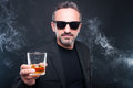 Exclusive man holding glass of whiskey Royalty Free Stock Photo