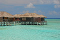 Exclusive spacious overwater bungalow for your next vacation open for booking in the middle of nowhere in far away place exotic Royalty Free Stock Photo