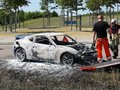 Exclusive sports car caught fire in the middle of the highway Royalty Free Stock Photo