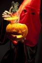 Executioner with halloween  pumpkin Stock Image