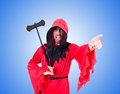 Executioner in red costume with axe on the white Royalty Free Stock Photo