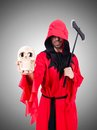 Executioner in red costume with axe on the white Stock Images